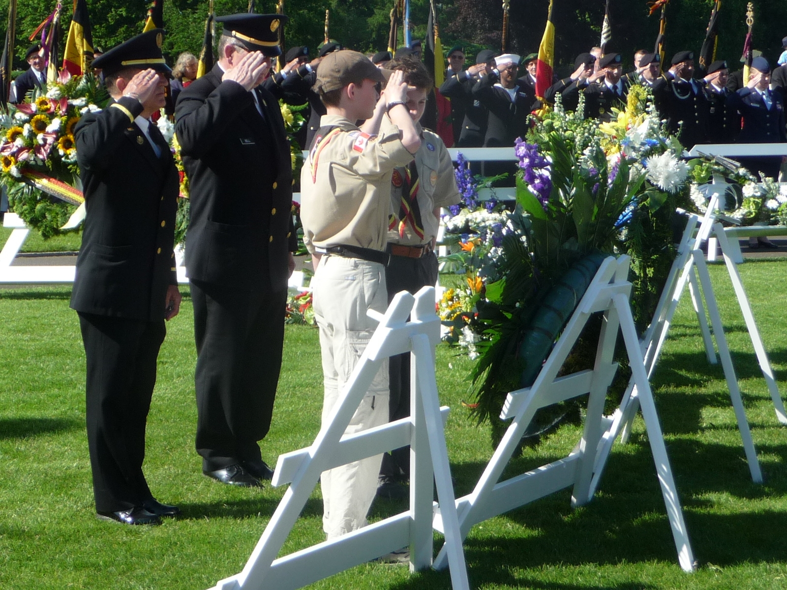 Attendees salute a wreath during the 2012 Memorial Day ceremony at Henri-Chapelle American Cemetery.