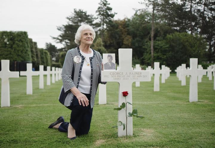 Carol LaBounty at her father's grave at Normandy American Cemetery