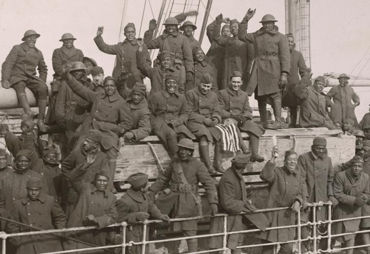 Members of the 369th Harlem Hellfighters infantry division return home to New York from France in February of 1919. Photo via National Archives, originally captured by Western Newspapers Union