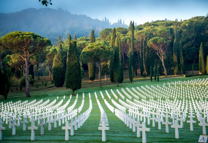 Rows of marble headstones dot the rolling landscape at Florence American Cemetery.
