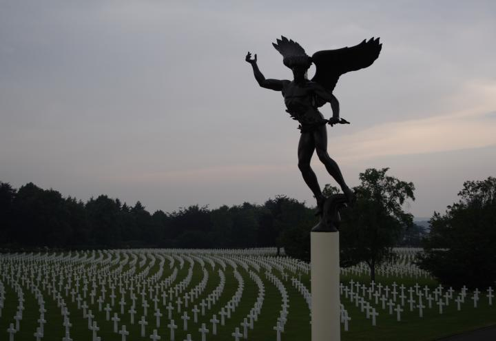 An angel statue looks over the rows of headstones at Henri-Chapelle American Cemetery.