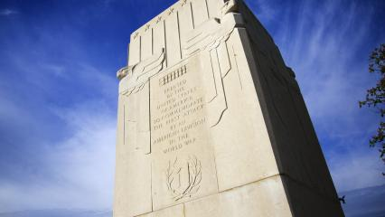 "Inscription on the monument reads: ""Erected by the United States of America to Commemorate the First Attack by an American Division in the World War."""