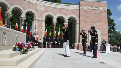Marines salute after laying wreaths.