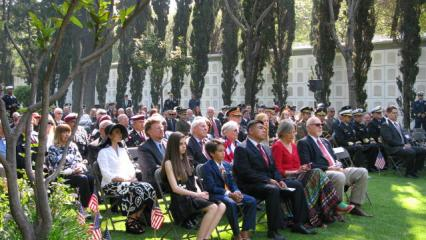 Attendees sit during the ceremony.