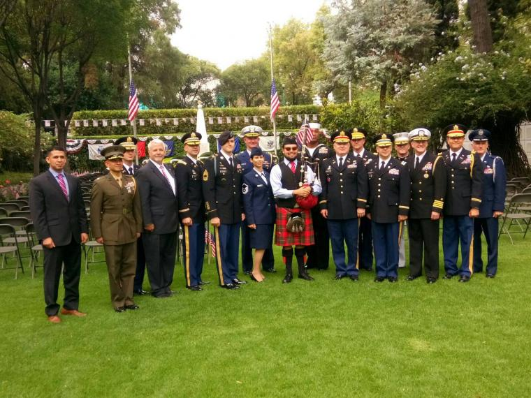 Attendees, mostly members of the American military, stand for a group photo.