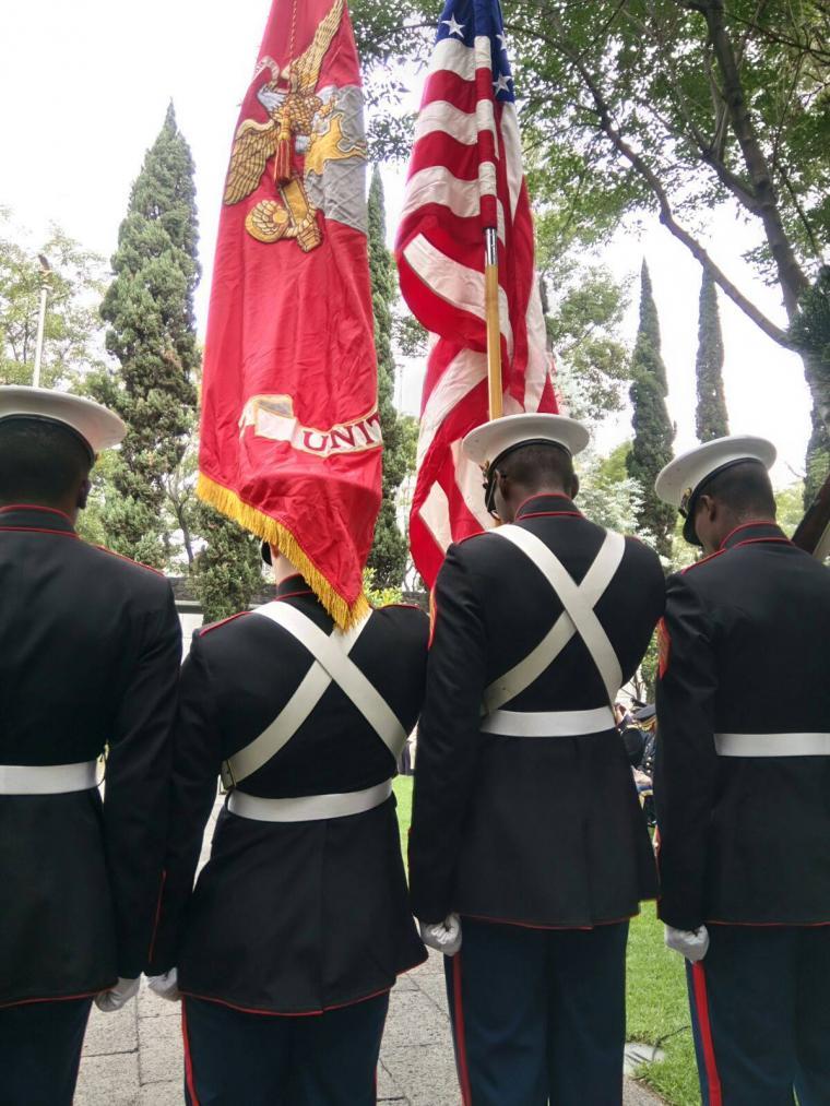 Marines stand shoulder to shoulder.