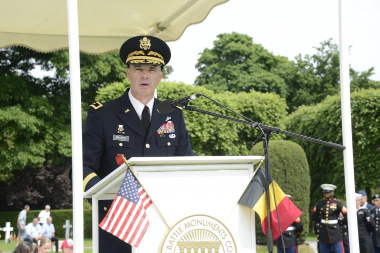 Man in uniform delivers remarks from the podium.
