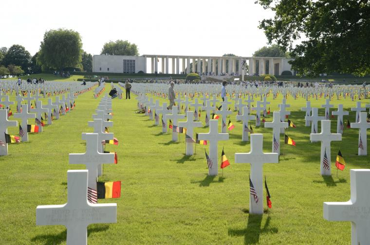 Rows upon rows of headstones have the American and Belgian flags.