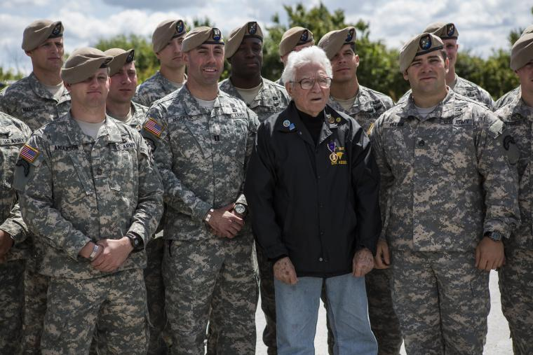 WWII vet Tony Vaccaro stands with members of the Army Rangers.