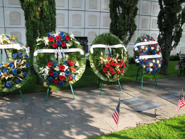 Large floral wreaths were laid during the ceremony.