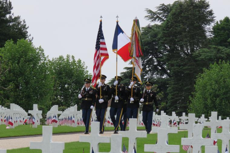 Members of the Honor Guard march through the cemetery.
