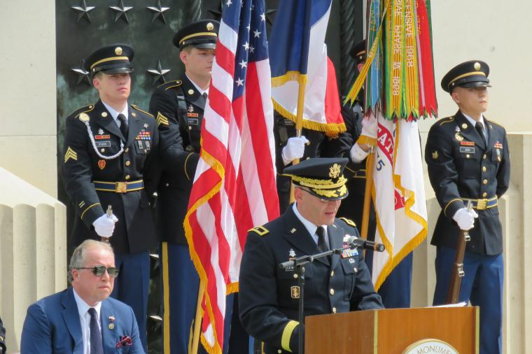 An Army officer delivers remarks from the podium.
