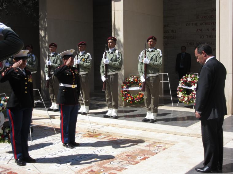 Two Marines salute the ambassador after he laid the wreath.