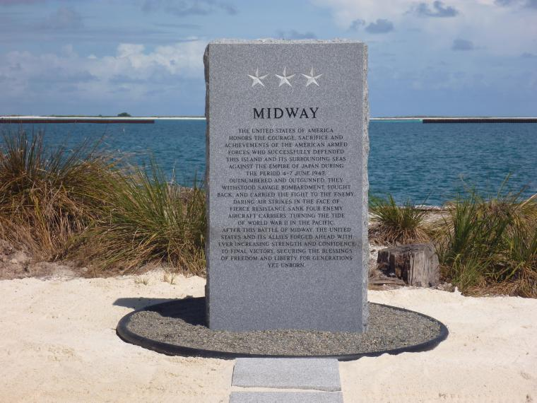 """This monument, a granite """"memory stone,"""" is etched with a historical tribute to America's armed forces."""