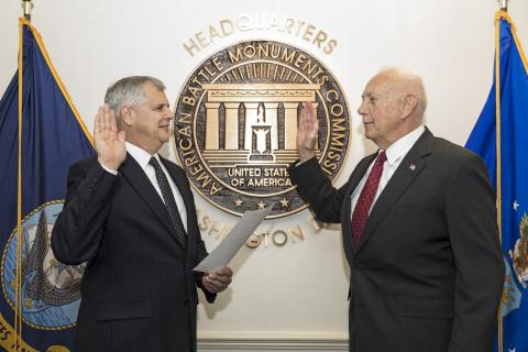 Dalessandro and Matz face each other with a hand raised as the oath is recited.