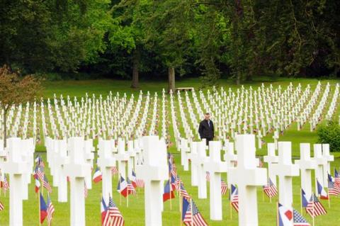 An American and French flag are at the base of every headstone.