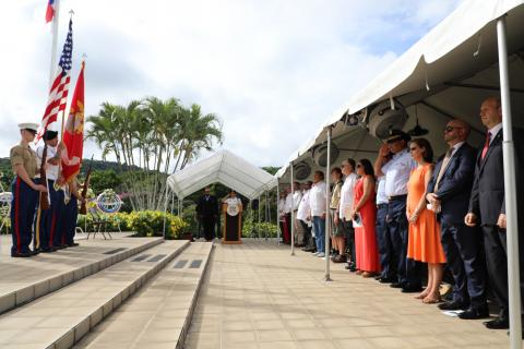 Attendees stand at the beginning of the ceremony.