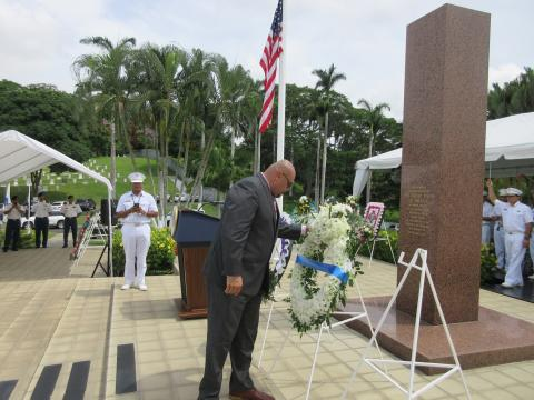 Villalobos pauses to reflect after laying the wreath.