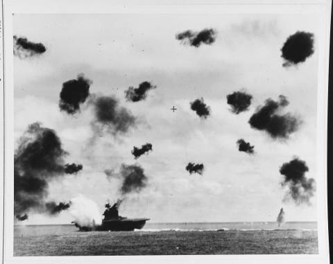 Historic photos shows smoke coming from ship and heavy antiaircraft fire.