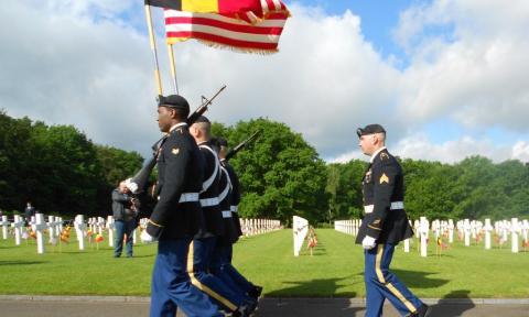 Men in uniform march.