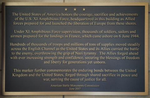 Text of this plaque commemorates the headquarters for the XI Amphibious Force.