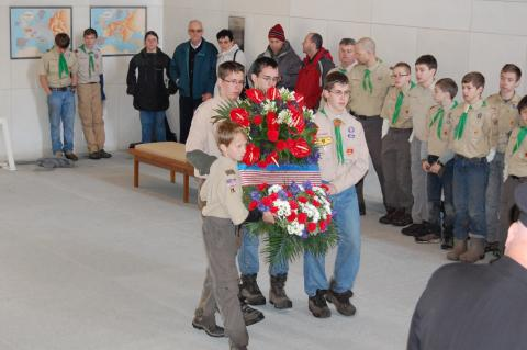 Boy scouts carry a wreath in the chapel.