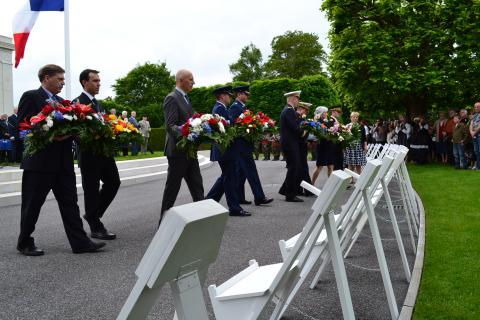 Members of the official party prepare to lay wreaths during the ceremony.