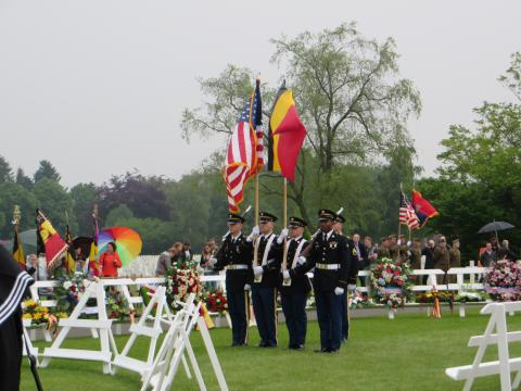A U.S. Color Guard stands at attention during the ceremony.