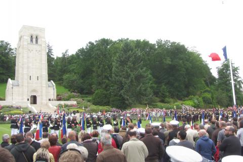 Thousands of people stand during the ceremony to get a glimpse of the event.