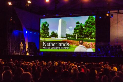Netherlands American Cemetery Superintendent Keith Stadler greets the audience prior to the film screening.