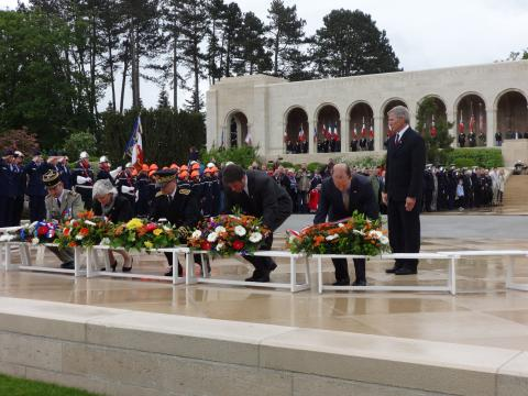 Members of the official party lay floral wreaths during the ceremony.