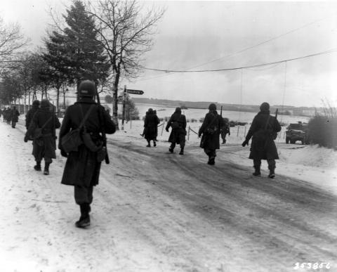 Members of the 101st Airborne move out of Bastogne.
