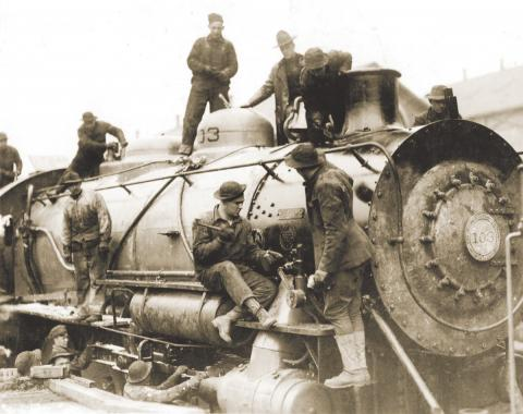 Services of Supply (SOS) soldiers build a locomotive at the assembly plant in St. Nazaire.