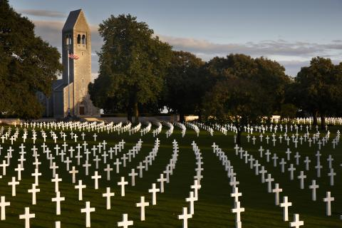 Sweeping arcs of headstones dot the landscape at Brittany American Cemetery.